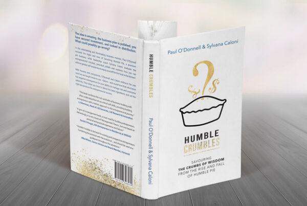 """Humble Crumbles: Savouring the crumbs of wisdom from the rise and fall of Humble Pie"" co-authored by Paul O'Donnell and Sylvana Caloni"